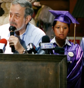Jessica Colotl stands behind Georgia Latino Alliance for Human Rights president Teodoro Maus during a press conference in Plaza Fiesta on Thursday, July 15, 2010. Colotl has become the poster child of illegal immigration conflict after her illegal alien status came to light